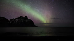 Northern lights aurora borealis time lapse over ocean, Eystra Horn, Iceland 4k Stock Footage