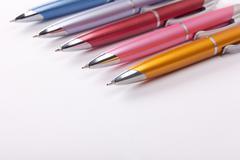 Ballpoint pens on table - stock photo