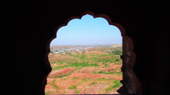 Tracking shot of the old blue city of Jodhpur seen from the Mehrangarh Fort Stock Footage