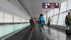 People walking by travelator in an aeroport gate and terminal area.. Slow motion Stock Footage