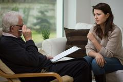 Talking with psychologist Stock Photos