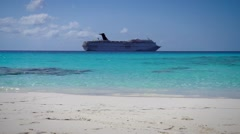 Caribbean beach and a cruise ship in background Stock Footage