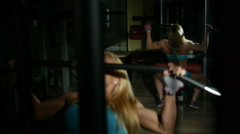 Young athlete woman doing exercises on Lat Machine Stock Footage