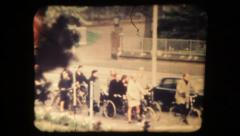 People on bicycles in the city . Vintage 8mm Stock Footage