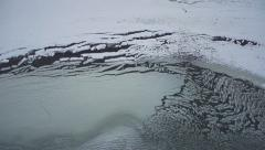 Aerial Slushy Ice over Shoreline Patterns in Winter at Low Tide - stock footage