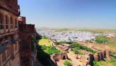 Panning shot of the old blue city of Jodhpur seen from the Mehrangarh Fort Stock Footage