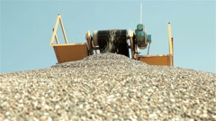 Sand falling from conveyor belt on pile of sand. Construction industry, open pit Stock Footage