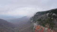 Low Hanging Clouds over Mountain Stock Footage