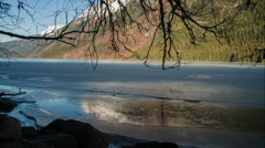 Chilkoot Lake in Early Spring Under Branches over Ice Slide Left Stock Footage