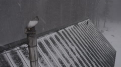 Chimney Flue of Alaskan House Aerial in Snowstorm Stock Footage