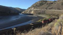 Coal Train in Canada on Fraser River High Angle 4K Stock Footage