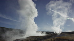 Wide shot of steam rising from Old Faithful geyser / Yellowstone National Park, - stock footage