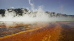 Wide panning shot of steam rising from Grand Prismatic spring / Yellowstone Stock Footage