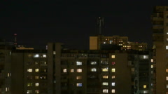 Night city. The light in the Windows of tall buildings Stock Footage