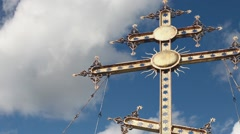 Gold cross against the sky Stock Footage