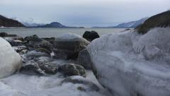 Diagonal Rise Icy Boulders on Shore Wintertime Chilkat Inlet Haines Stock Footage