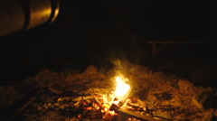 Dousing the Campfire with Bucket of Water Stock Footage
