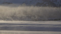 Drifting and Glowing Mists of Steam off Frozen River Landscape 4K Stock Footage