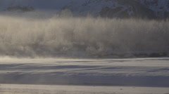 Drifting and Glowing Mists of Steam off Frozen River Landscape HD Stock Footage