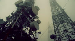 Stock Video Footage of Communication cell towers, antennas site, mountain mist and fog