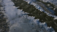 Early Winter River Aerial Following Water Downstream Channel Stock Footage