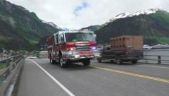 Stock Video Footage of EMS Fire Truck Rushes Past on Bridge Handheld Juneau Alaska 4K