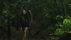 Medium shot of curious couple hiking and exploring jungle / Arenal, Costa Rica Stock Footage