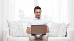 Man working with laptop computer at home Stock Footage