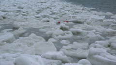 Flotation Device Lost Tossing in Sea of Patchy Drift Ice in Arctic  - stock footage