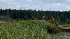 Bulldozer tractor moving soil in marshland. Stock Footage