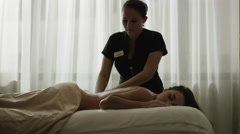 Slow motion zoom in shot of woman having massage / Arenal, La Fortuna, Costa Stock Footage