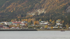 Haines AK Autumn Cloudy Med Over Water with Fishing Boat Stock Footage