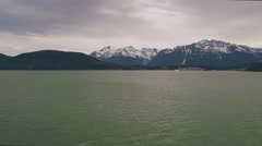 Haines AK Cloudy From Ferry Long Shot Pan Right Stock Footage