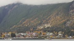 Haines AK in Autumn LS over Water Cloudy with Fishing Boat Stock Footage