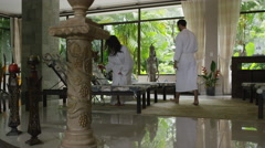 Slow motion zoom in shot of couple relaxing in spa resort / Arenal, La Fortuna, Stock Footage
