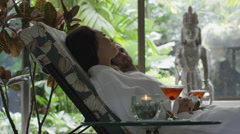 Medium low angle panning shot of couple relaxing in spa / Arenal, La Fortuna, Stock Footage