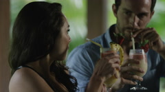 Close up tracking shot of couple toasting with tropical drinks / Arenal, La Stock Footage