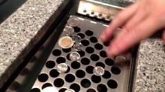 Close up hand to pushing coin to chute Stock Footage