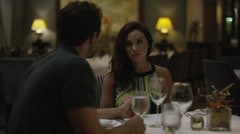 Medium shot of couple arguing in restaurant / Arenal, La Fortuna, Costa Rica Stock Footage