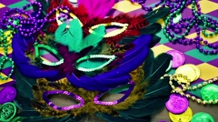 Multicolored decorations for Mardi Gras party on the table. Stock Footage