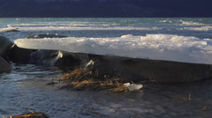 Ice Raft Stranded on Rock with Windswept Chilkat Waters Dolly Pan 4K Stock Footage