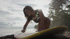 Low angle close up shot of surfer waxing surfboard on beach / Esterillos, Stock Footage