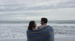 Wide shot slow motion view of couple admiring scenic view on beach / Esterillos, Stock Footage