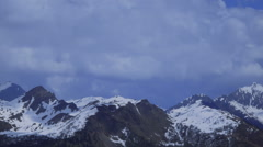 Timelapse view, Clouds and snow-capped mountains in the Swiss Alps Stock Footage