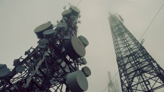 Communication cell tower, antennas site, mountain mist and fog Stock Footage