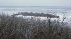 Ice-covered river with island winter landscape Stock Footage