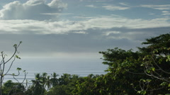Wide shot of treetops over seascape / Esterillos, Puntarenas, Costa Rica Stock Footage