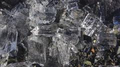 Jagged Ice Broken on Rocky Shore Slide Left CU 4K Stock Footage