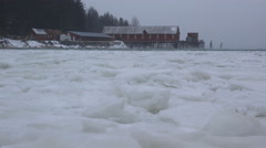 Stock Video Footage of Letnikof Cannery in Winter Storm Ice Chunks Floating Waves 4K