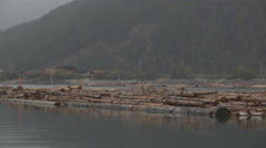 Log Raft Logging Deck Operation in Canada River Foggy Pan Left 4K Stock Footage